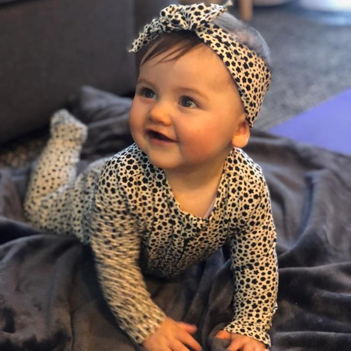 Baby Elle looking adorable in her matching outfit.