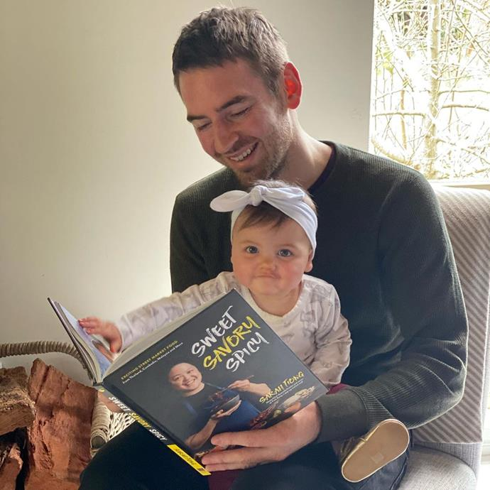 Callum chose a different book for story time with Elle this day - he read out fellow *MasterChef* contestant Sarah Tiong's cookbook, *Sweet Savoury Spicy*.