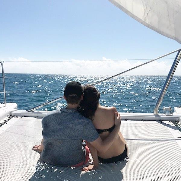 The cute couple enjoying a quiet, romantic moment together by the sea.