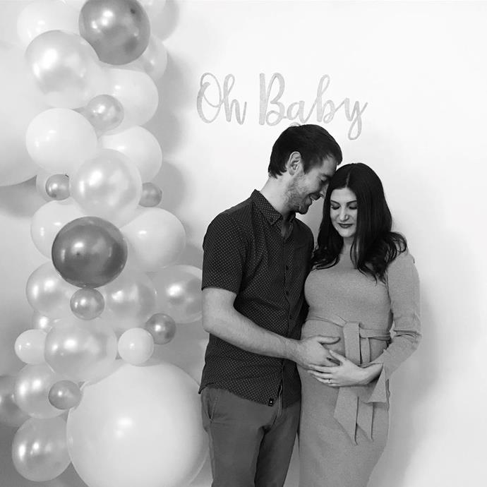 The couple celebrating at their baby shower, months before they met Elle.