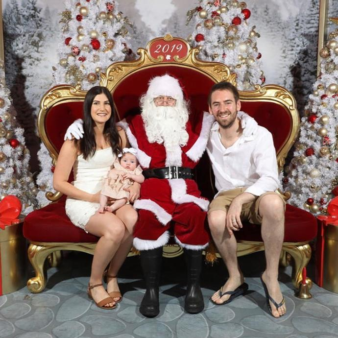 Celebrating Elle's first Christmas last year with a special photo with Santa.