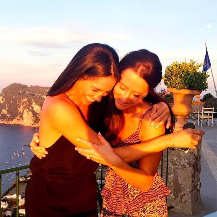 This candid snap shows the friends hugging while on vacation, during happier times.