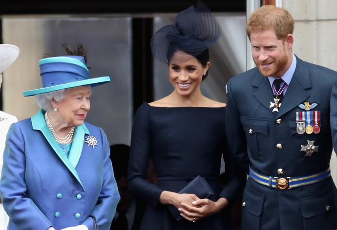 Queen Elizabeth II, Meghan Duchess of Sussex and Prince Harry, Duke of Sussex watching the RAF flypast in 2018