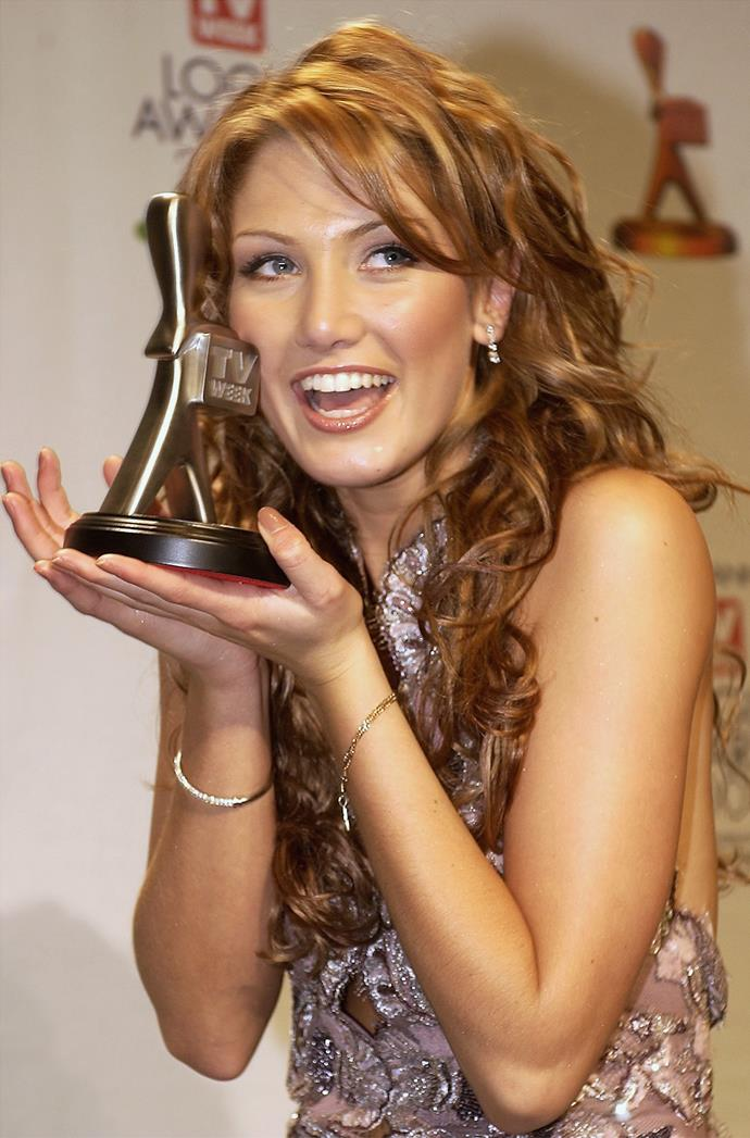 Delta holding her coveted trophy.