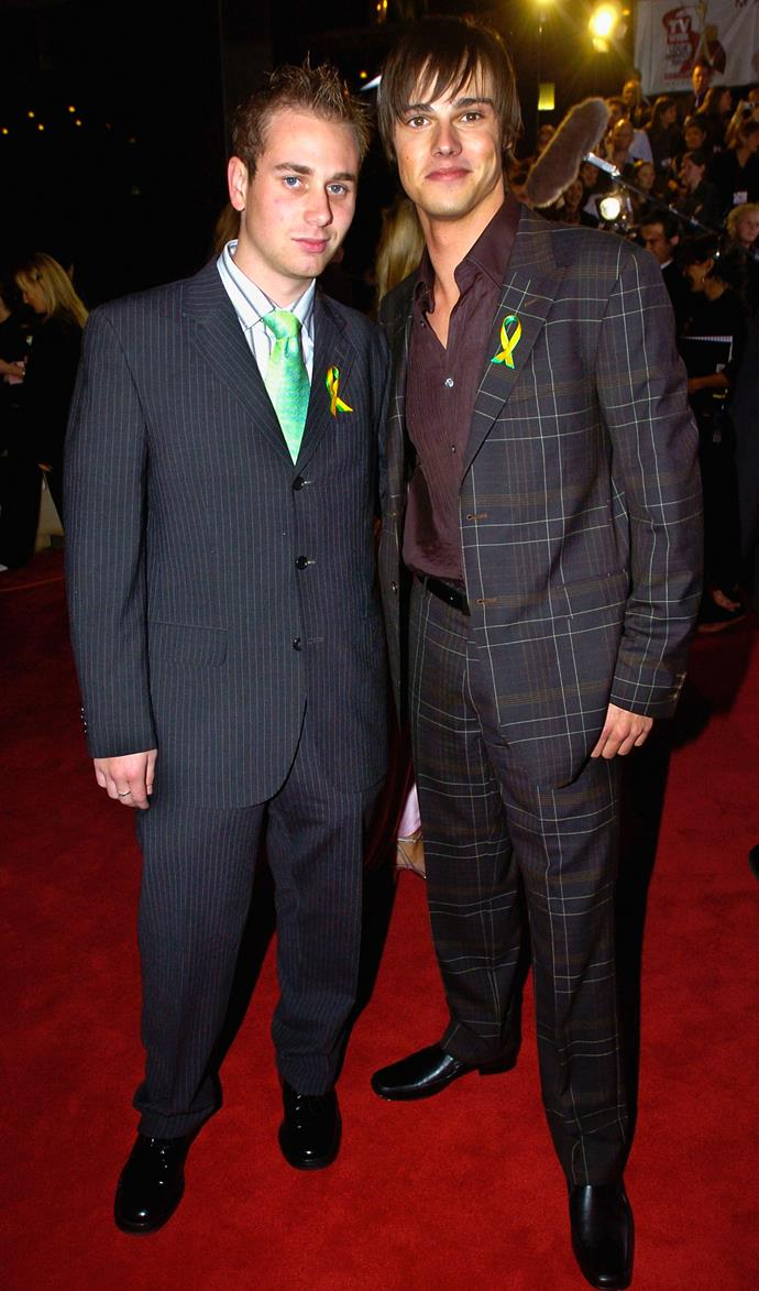 Oh yes, 2004 was *quite* the time. Remember when pinstripe and tartan suits were a thing? Patrick Harvey and Jay Bunyan certainly do...