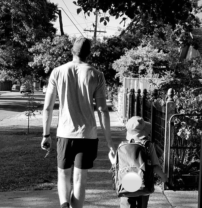 Shaun and River holding hands while walking to school together.