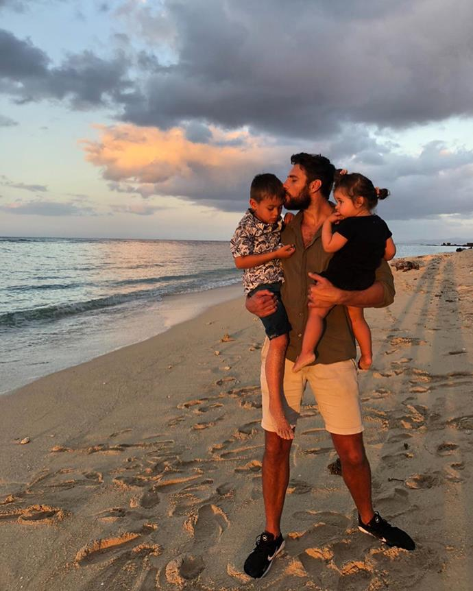 Doting father Shaun watching the sunset with his little ones.