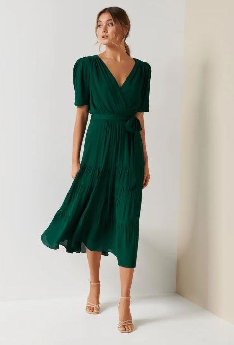 "If you're vibing more of an airy style for summer, Forever New's puff-sleeved floaty green midi dress is a great option. $159.99, [buy it online here](https://www.forevernew.com.au/jordan-puff-sleeve-tiered-midi-dress-263907?colour=green|target=""_blank""