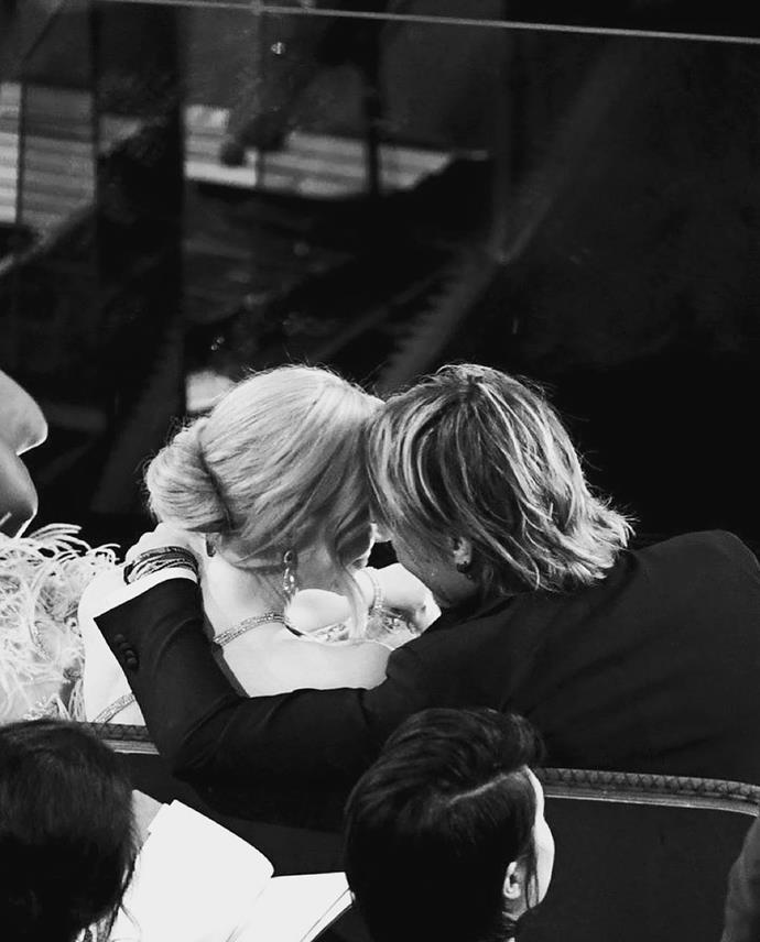 The couple sharing a sweet moment together in the middle of an awards ceremony.