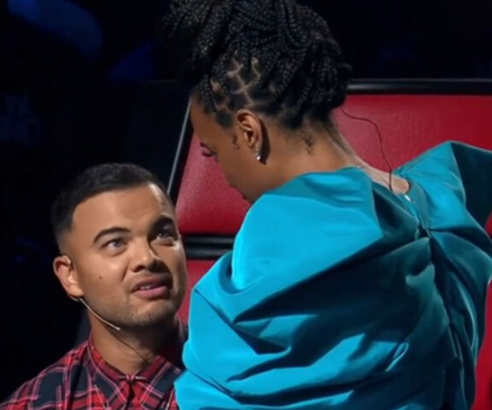 Coaches Guy Sebastian and Kelly Rowland have been at each other's throats on *The Voice* this season.
