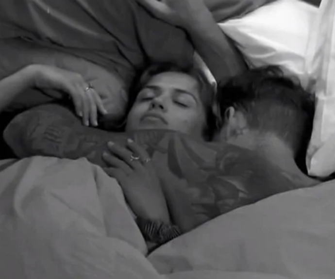 Sophie and Chad sharing an intimate moment in bed together in the *Big Brother* house.