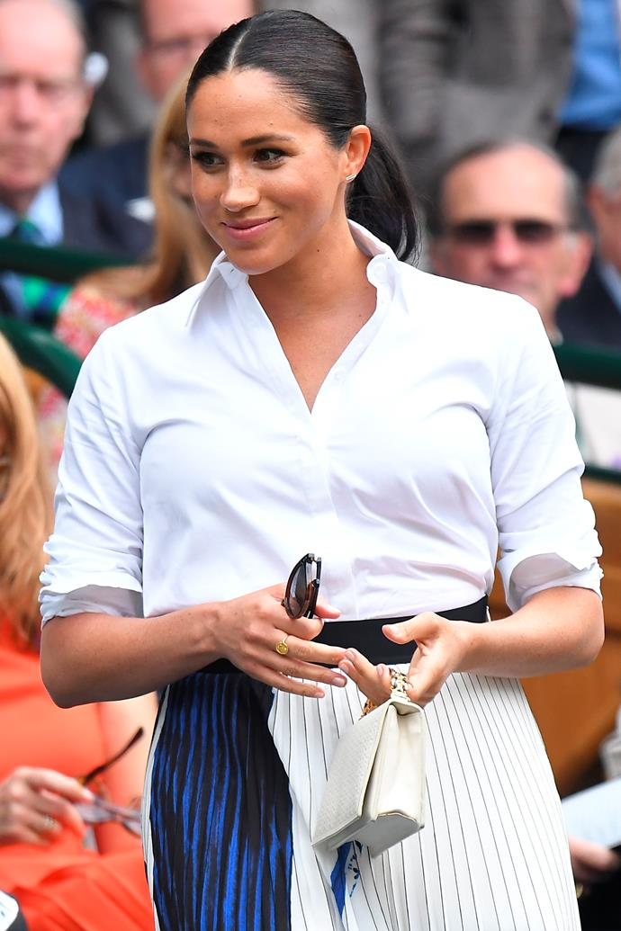 Shortly after giving birth to her son Archie, Meghan upped the fashion stakes in this crisp white shirt and pleated skirt designed by Hugo Boss as she watched the Women's singles final take place in 2019.