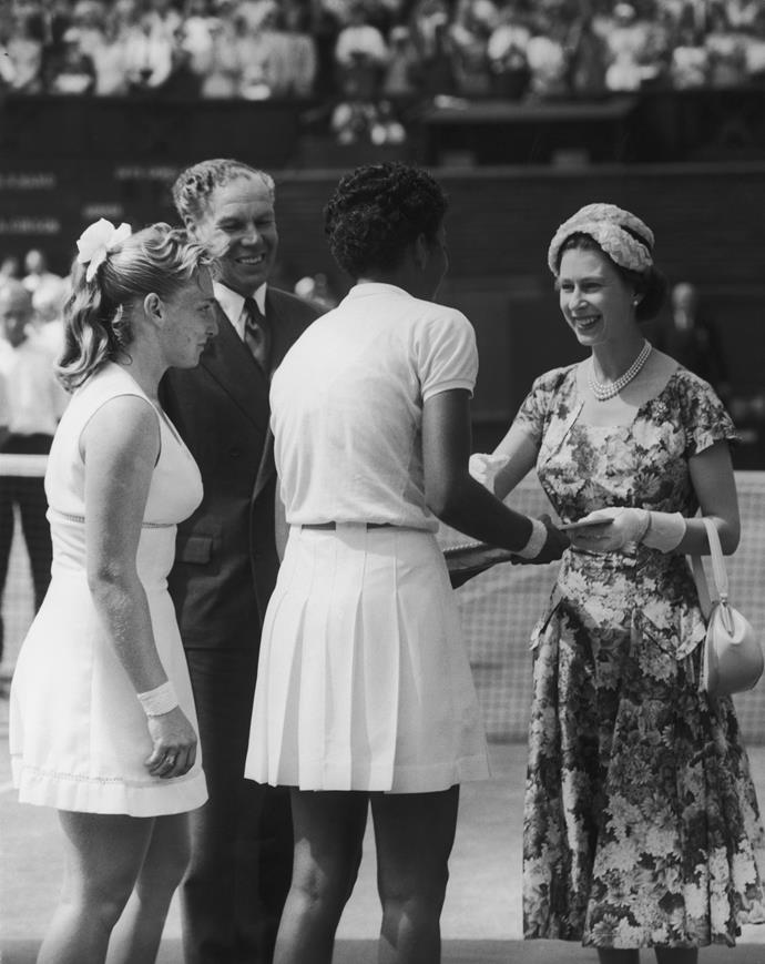 Wearing a gorgeous fitted floral design, The Queen was the epitome of Fifties summer style at the 1957 Wimbledon Championships.