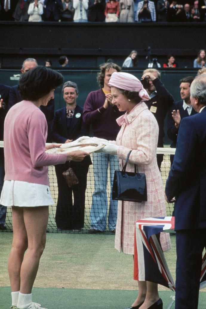 The Queen was one of many to make pink the new, well... *white* at the prestigious tournament. She's pictured here in 1977.