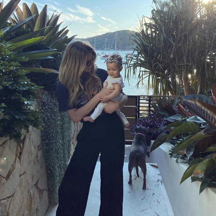 Jen and Frankie posed with their adorable dog, just by the ocean.