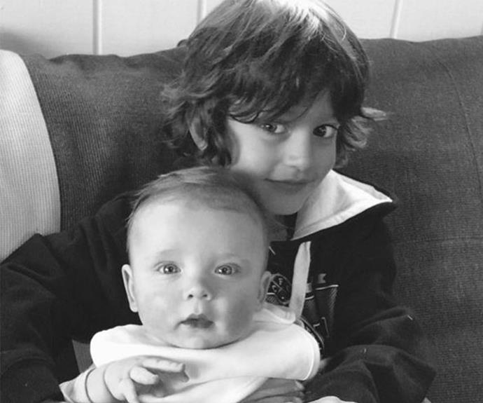 Brothers in arms: Proud big brother Luca holds a Valentino when he was a baby.