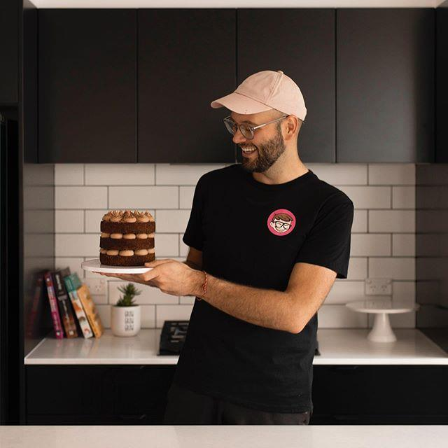 Reece pictured with one of his classic custom Cakeboi cakes.