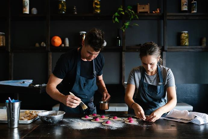 Laura and her husband Max working in the kitchen together at Nido Bar.