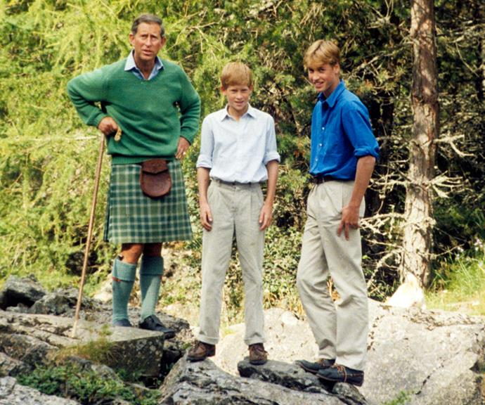 Prince Charles, Prince William and Prince Harry relax together on the banks of the river Dee in Balmoral in 1997.