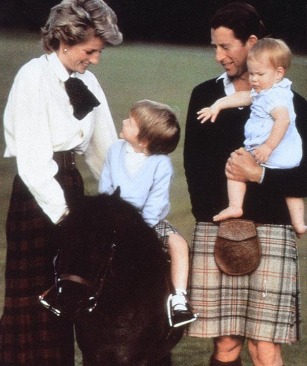 Prince Charles, pictured with Princess Diana and a young Prince William and Prince Harry at Balmoral in 1988, always dons the Balmoral tartans when staying on the Scottish estate.