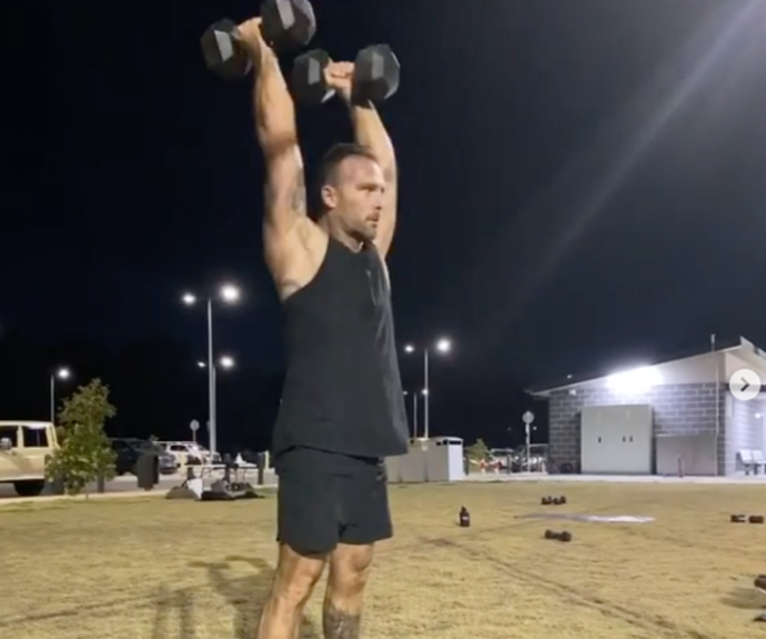 Steve lifted two massive dumbbells above his head in the clip.