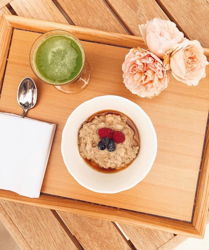 Miranda's breakfast - a glass of celery juice and porridge.