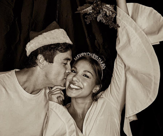 Sarah and James celebrating Christmas with a kiss, under some strategically-placed mistletoe!