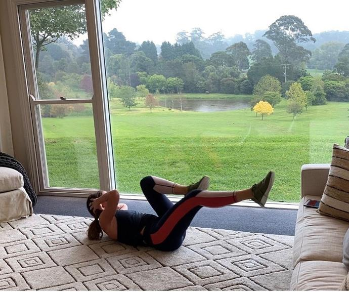 Michelle getting in her daily workout, while looking out at her property's amazing view.