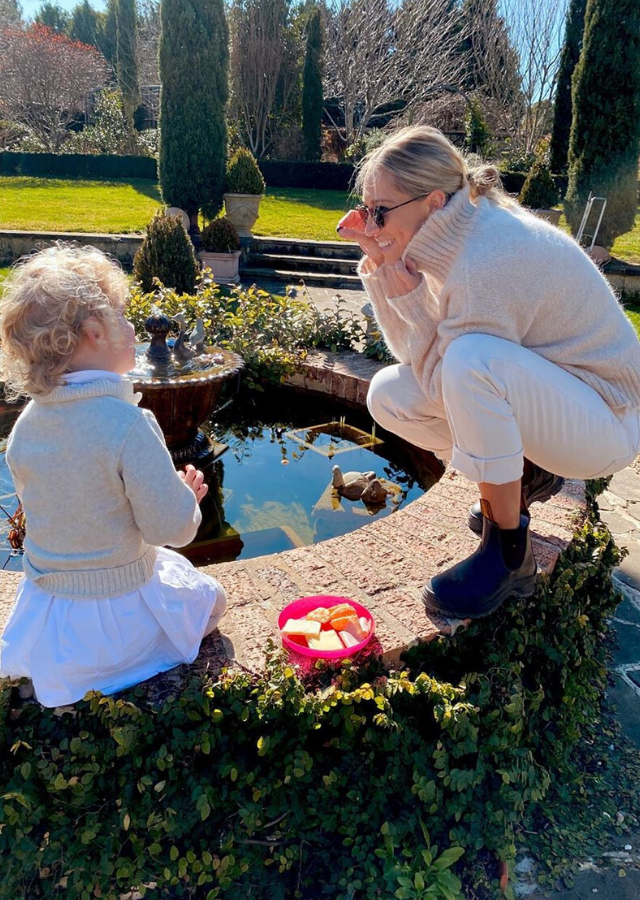 Phoebe played with her daughter Poppy in her parents' backyard in Bowral.