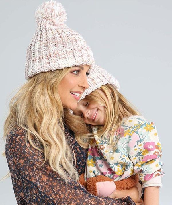 Model moment: Carrie and her daughter Evie cuddle up for the Beanies 4 Brain Cancer's offical press shots.