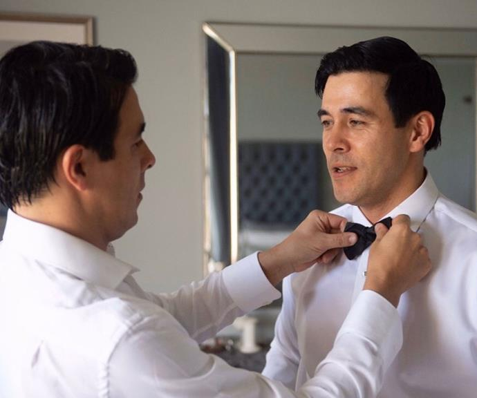 Best man Nick puts the finishing touches on James' bow-tie ahead of his marriage to *Home And Away* co-star Sarah Roberts.