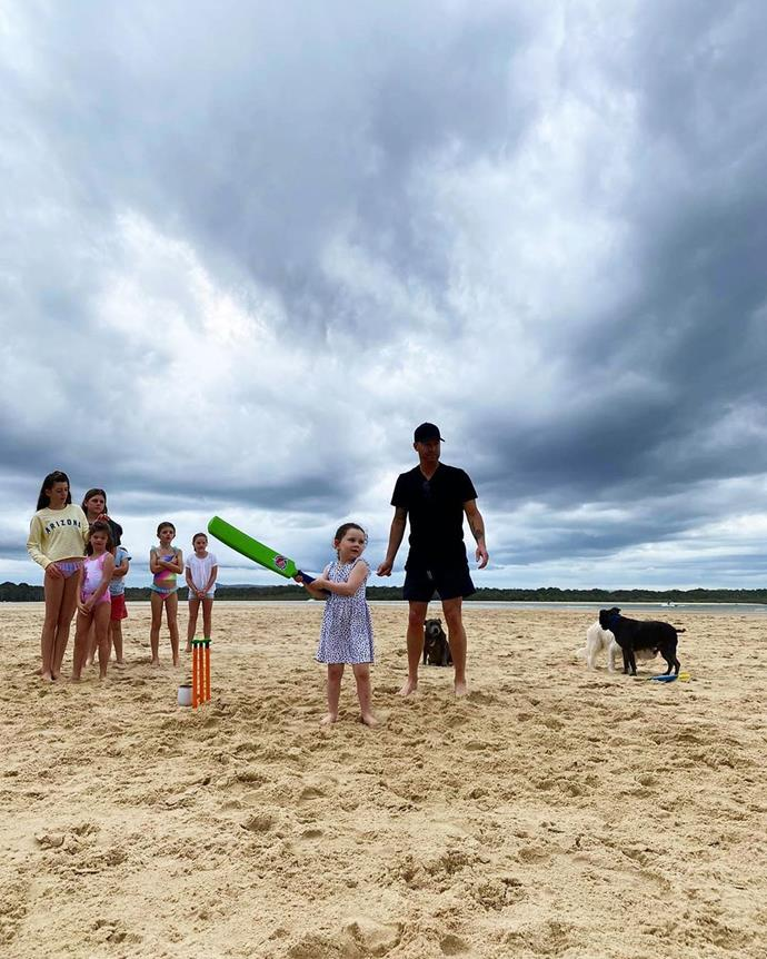 """You got this baby girl 🏏,"" Michael captioned this photo of his four-year-old daughter playing cricket on the beach."