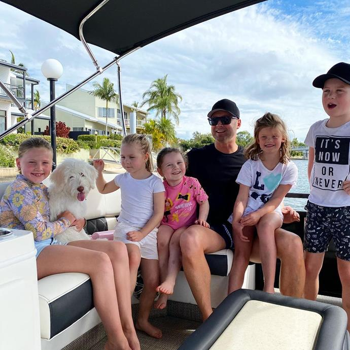 Michael looks like the ultimate doting father in this photo he posted of himself and daughter Kelsey-Lee hanging out on a boat, as they're joined by the children of his family and friends.