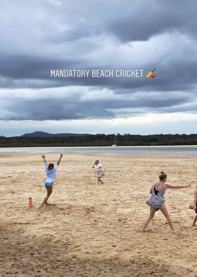 "At the same time, Pip uploaded this photo with the caption, ""Mandatory beach cricket."""