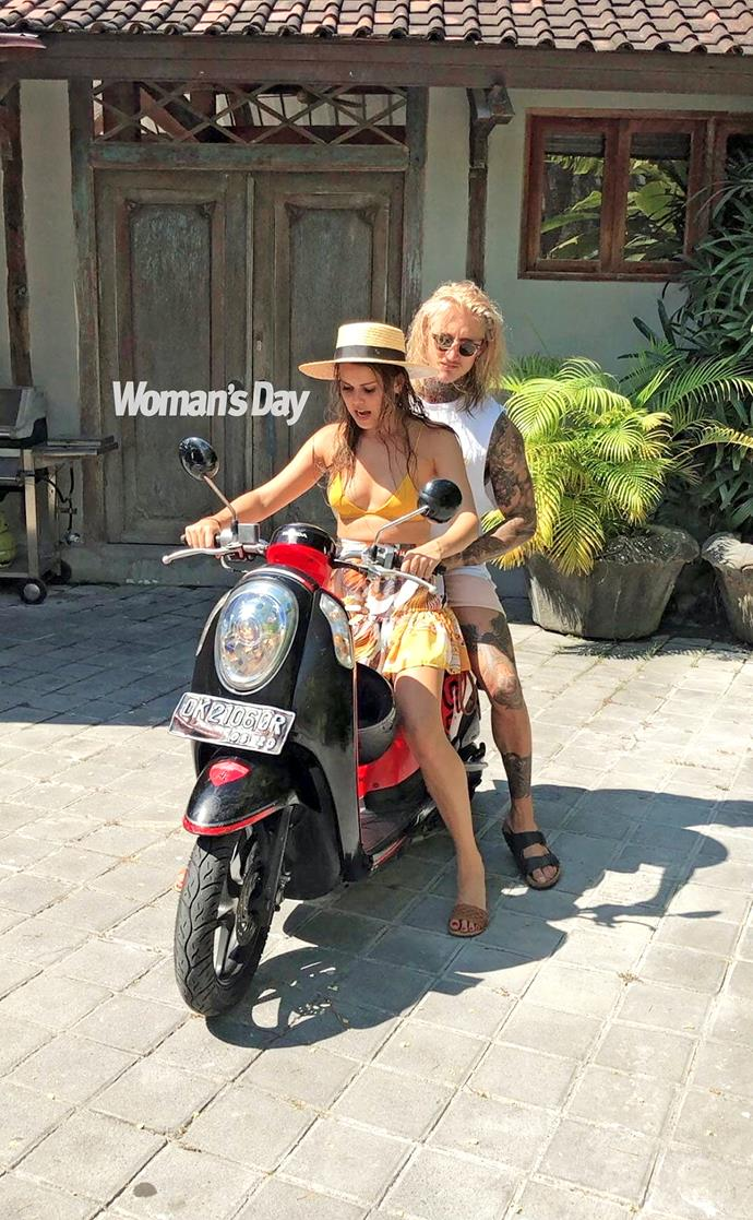 The couple pictured riding a bike together in Bali.