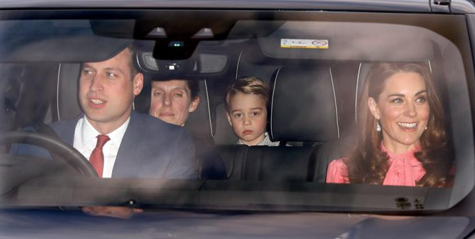 One was *not* amused - Prince George looked a little tuckered out after attending the Queen's annual pre-Christmas lunch at Buckingham Palace. Perhaps he overindulged on the Christmas pudding?