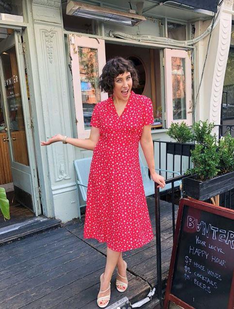 An NYC summer calls for the perfect 50s-esque midi dress with the perfect 80s-esque shag 'do. Coveting.