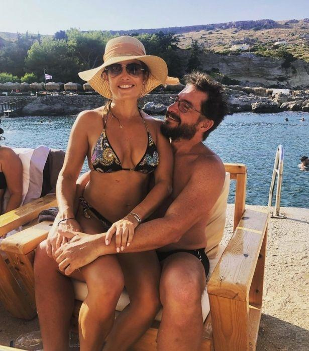 We've got serious holiday (and body) envy!<br><br>  The happy couple soaked up the sun while on vacation in Greece.