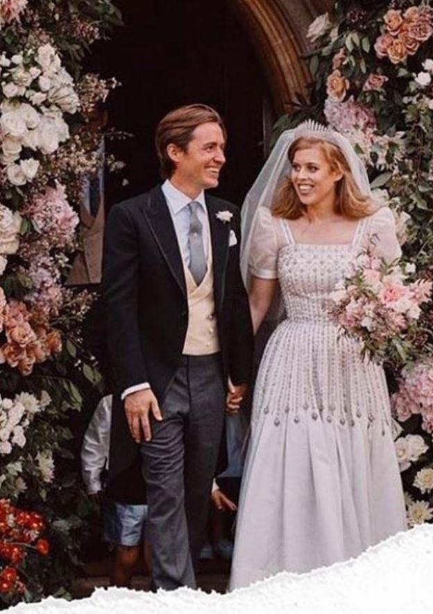 A new wedding picture surfaced on Instagram in the weeks following the pair's surprise nuptials in July, with the pair seen alongside Edo's son Wolfie - Can you spot him in the background? It's an extremely rare sighting of the four-year-old!