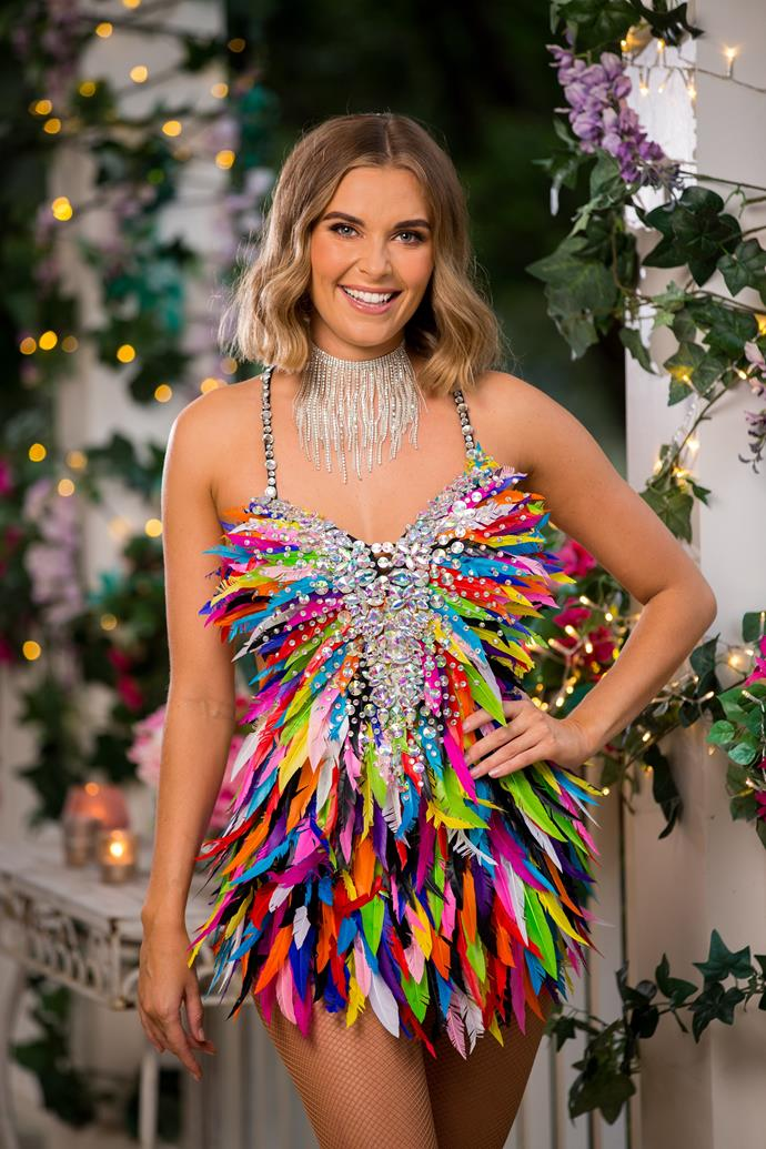 """**Nicole, 26, NSW** <br><br> Like her outfit suggests, Nicole is set to dance her way into Locky's arms as she rolls up for her first mansion meeting with the Bachie. Locky is clearly taken with her, telling the cameras: """"Nicole has a lot of energy and that's someone I want to be around."""" Looks like this is one first impression that'll make a lasting impact!"""