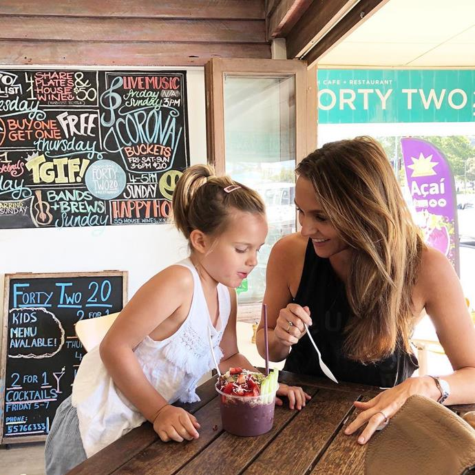 Natalie and Olivia sharing an acai bowl together while on holidays in Byron Bay.