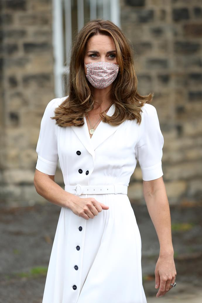 The Duchess looked ultra stylish on Tuesday in a floral face mask and white shirt dress - the very same she wore this time last year to Wimbledon.