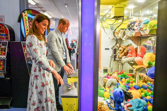 Duchess Catherine and Prince William tried their hand at some of the local arcade games.