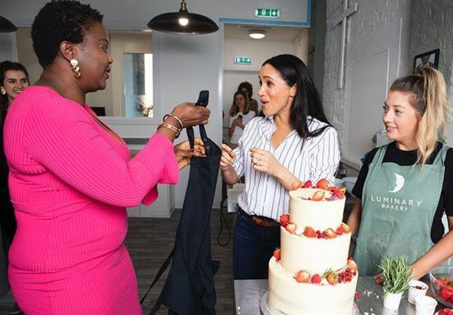 The gorgeous moment between Meghan and Monica was caught on camera.