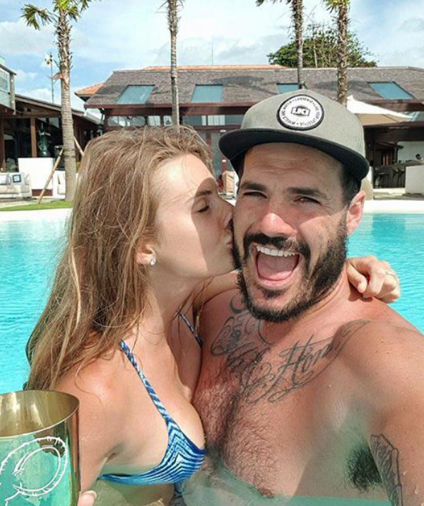 Locky, pictured here in Bali with ex-girlfriend Jordan Cayess, is based in the Indonesian island for most of the year.