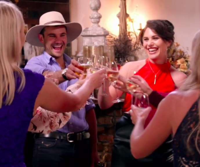 Farmer Alex and several contestants enjoying a drink together.