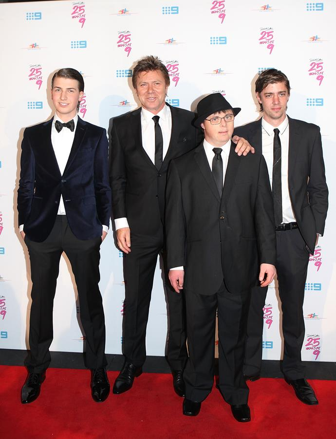 Richard and his three sons (L-R) Christian, Adam and Nick walk the red carpet in 2012.