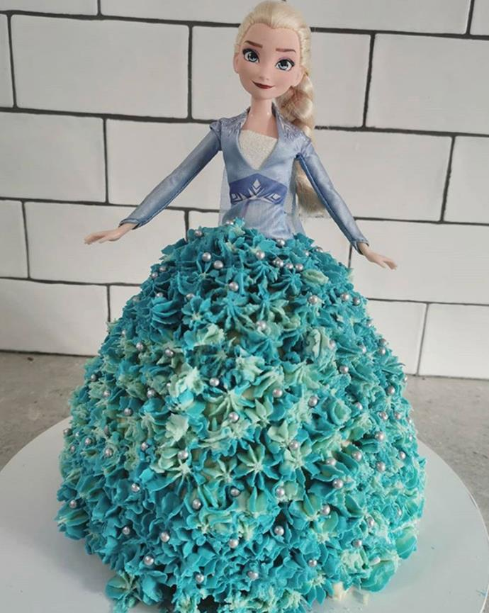 "Elsa in cake form! How clever is this *Frozen* take on [the Dolly Varden cake?](https://www.foodtolove.co.nz/recipes/australian-womens-weekly-dolly-varden-cake-2530|target=""_blank"")"