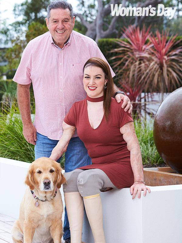 Sophie with her father and her beloved assistance dog Willow.