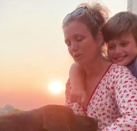 """Next to a beautiful backdrop, she have provided an update with son Otis on how he was faring, writing: """"Thank you everyone for your amazing thoughts, kind words, prayers - didn't think our Gus would make it, but he is well on his way to a full recovery."""""""